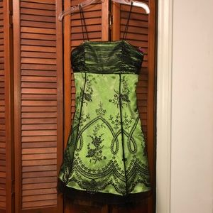 Beautiful green dress with black lace design